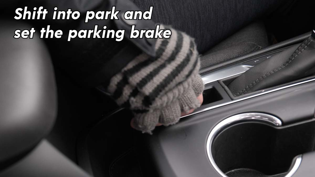 Shift into park and set the parking brake