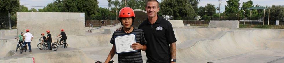 Brani Valencia and Tony Hoffman pose at a skatepark.
