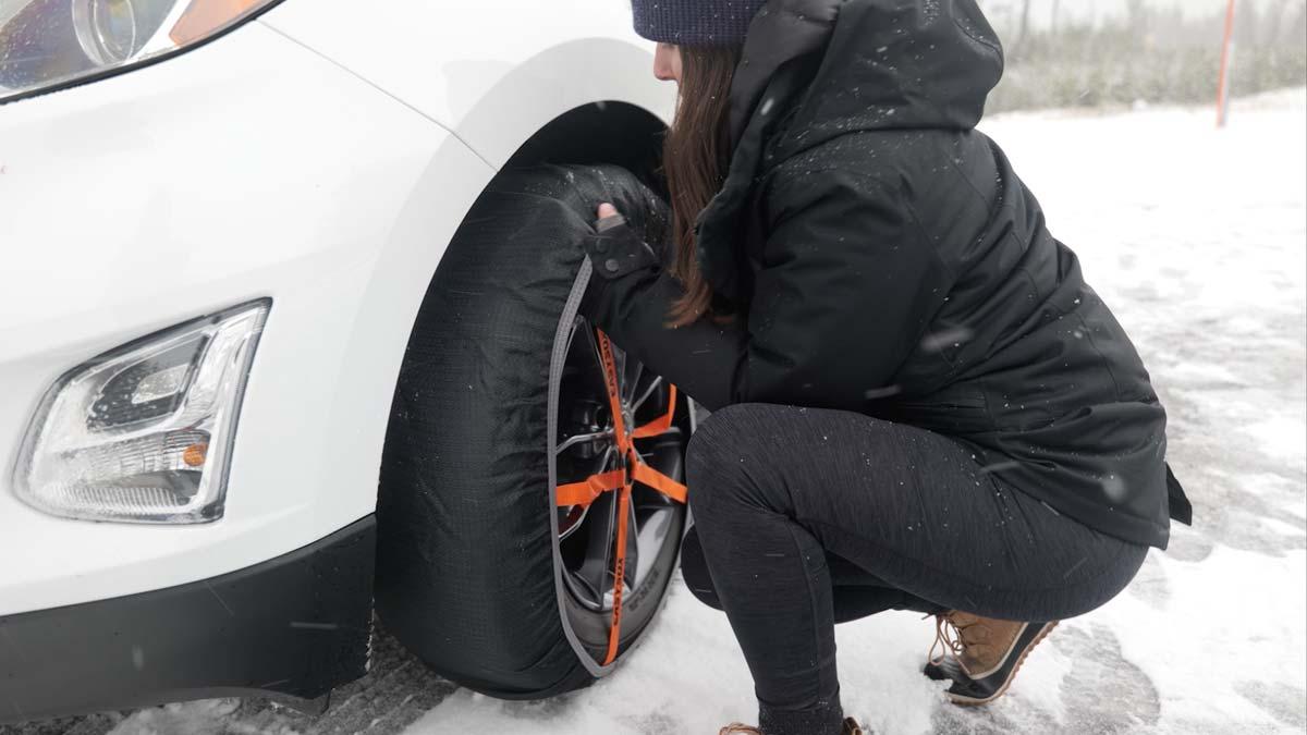 Girl installing tire sock