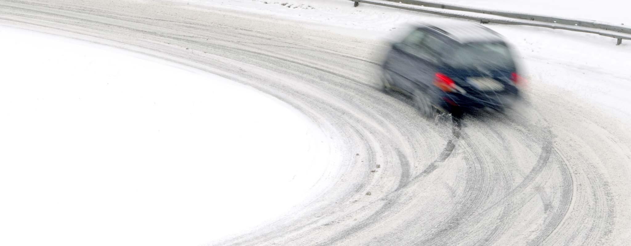 Car on snowy winter road.