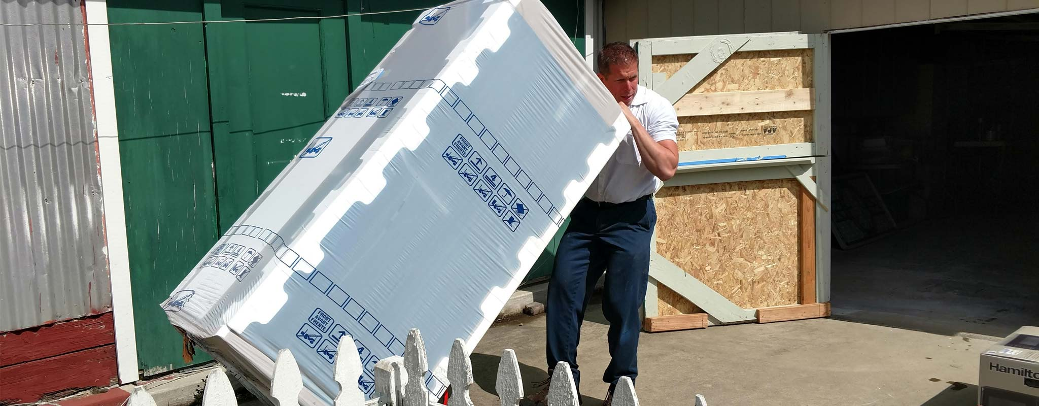 Les Schwab manager Brett Clark delivering a new fridge to the 4-H clubhouse.
