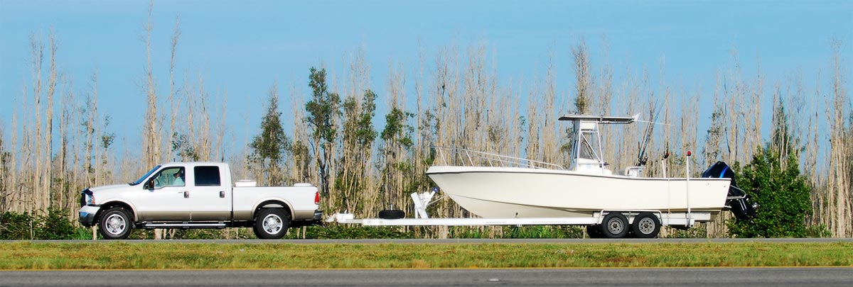 Truck towing boat trailer