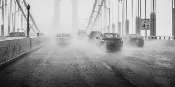 Cars on a wet rainy bridge