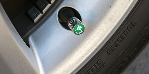 A green valve stem cap indicating Nitrogen filled.