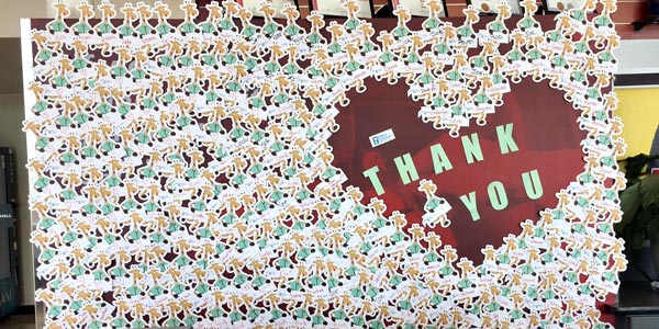 A Thank You poster at Valley Children's Hospital covered in lots of doctor giraffe stickers.