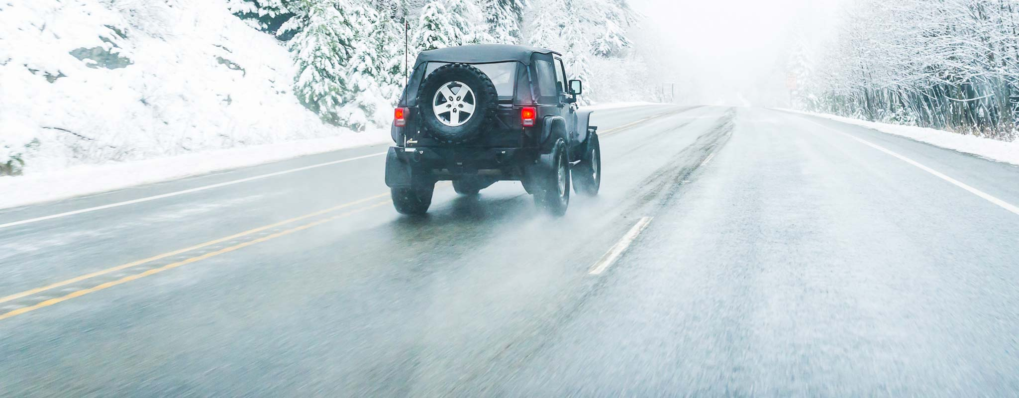 Jeep on snowy road.