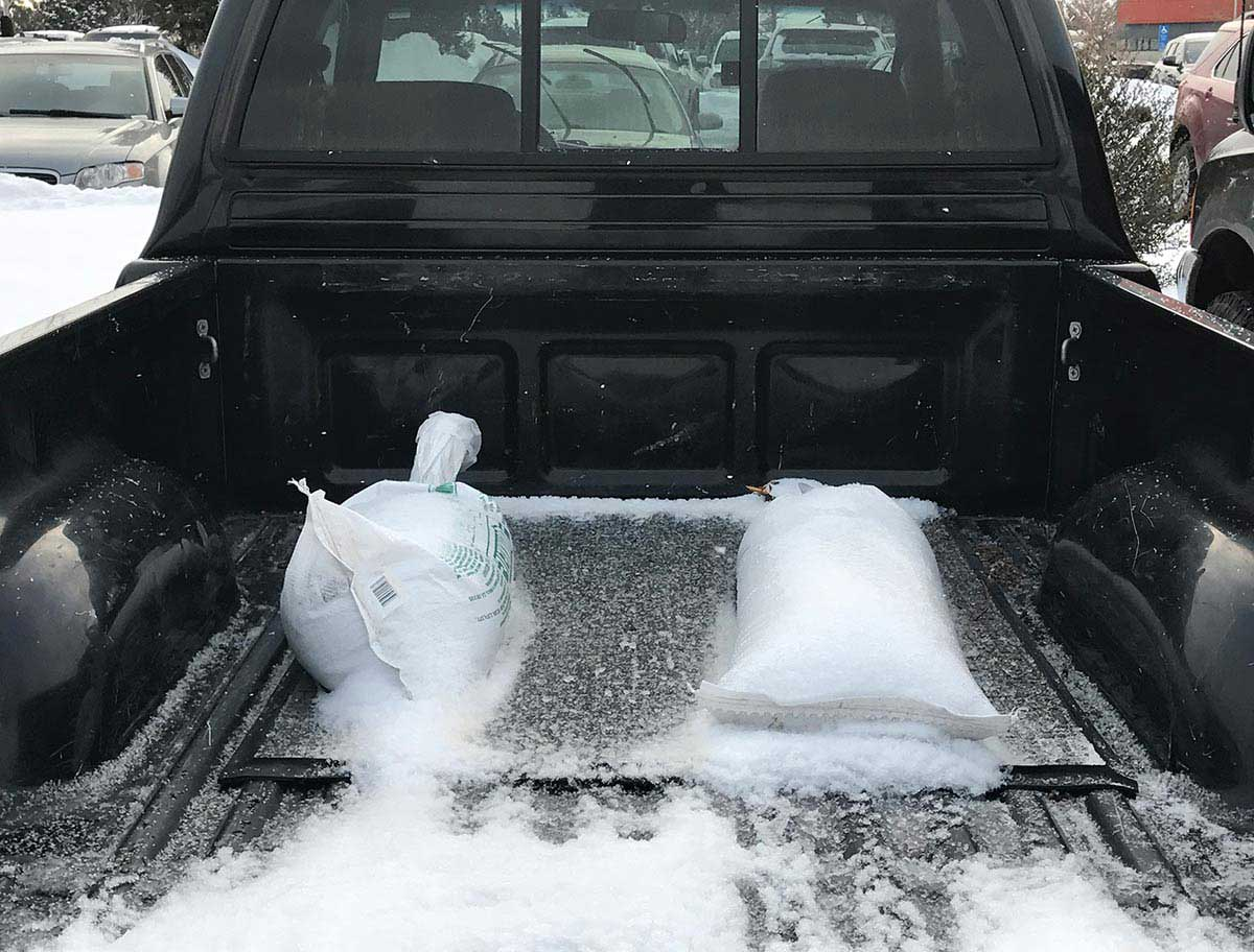 Sandbags in bed of pickup truck