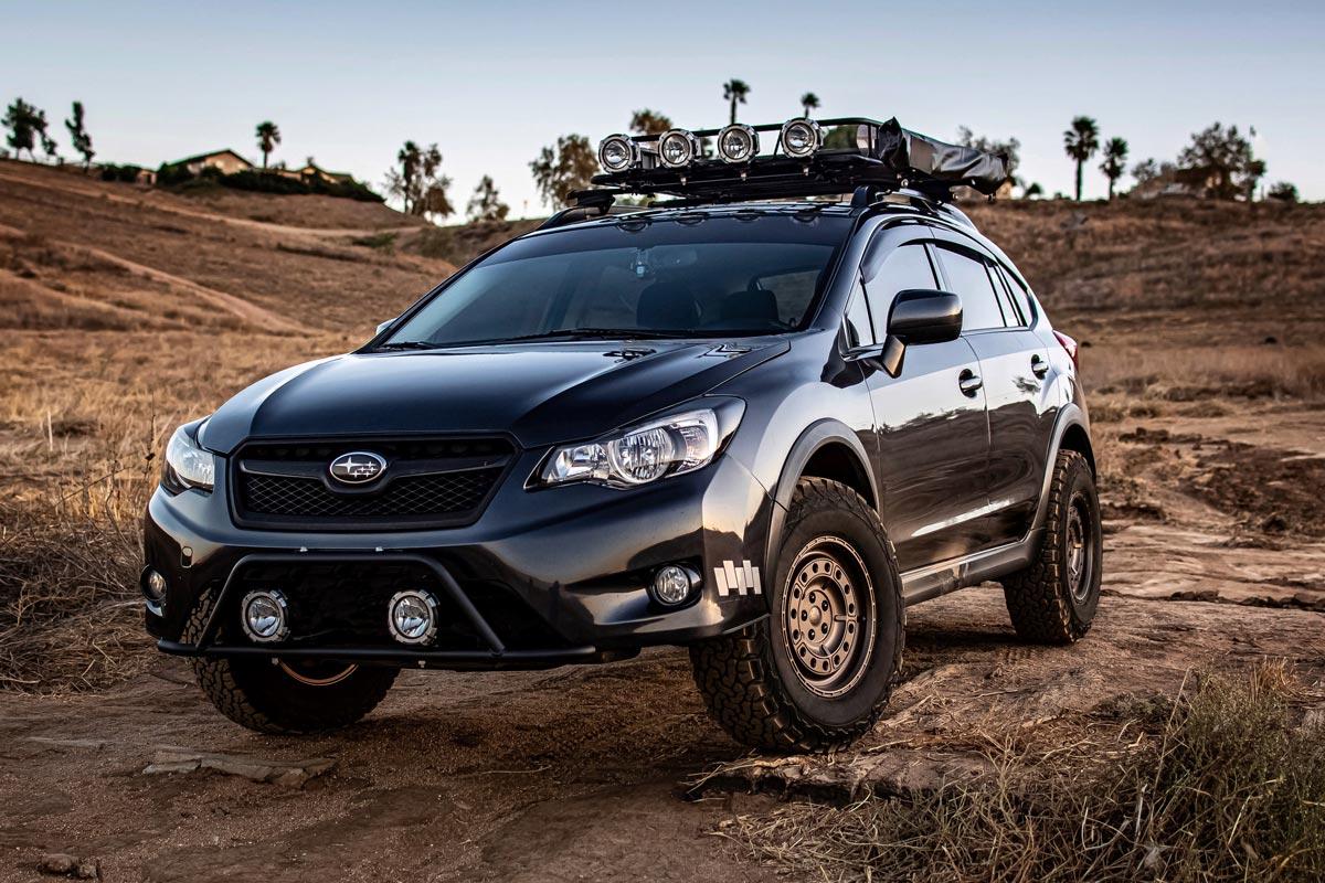 Black Subaru Crosstrek outfitted for overlanding in the desert
