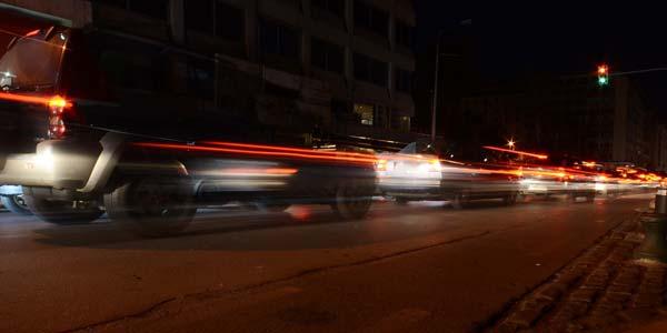 Brake lights shining on a busy city street.