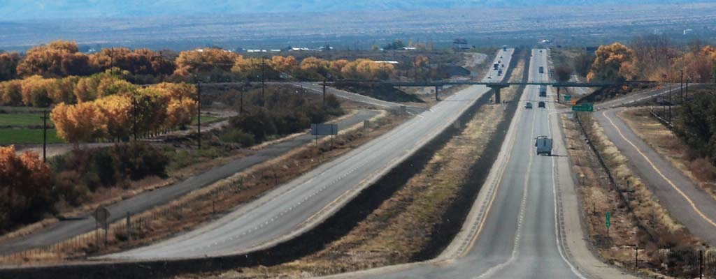 Four lane split highway in fall.