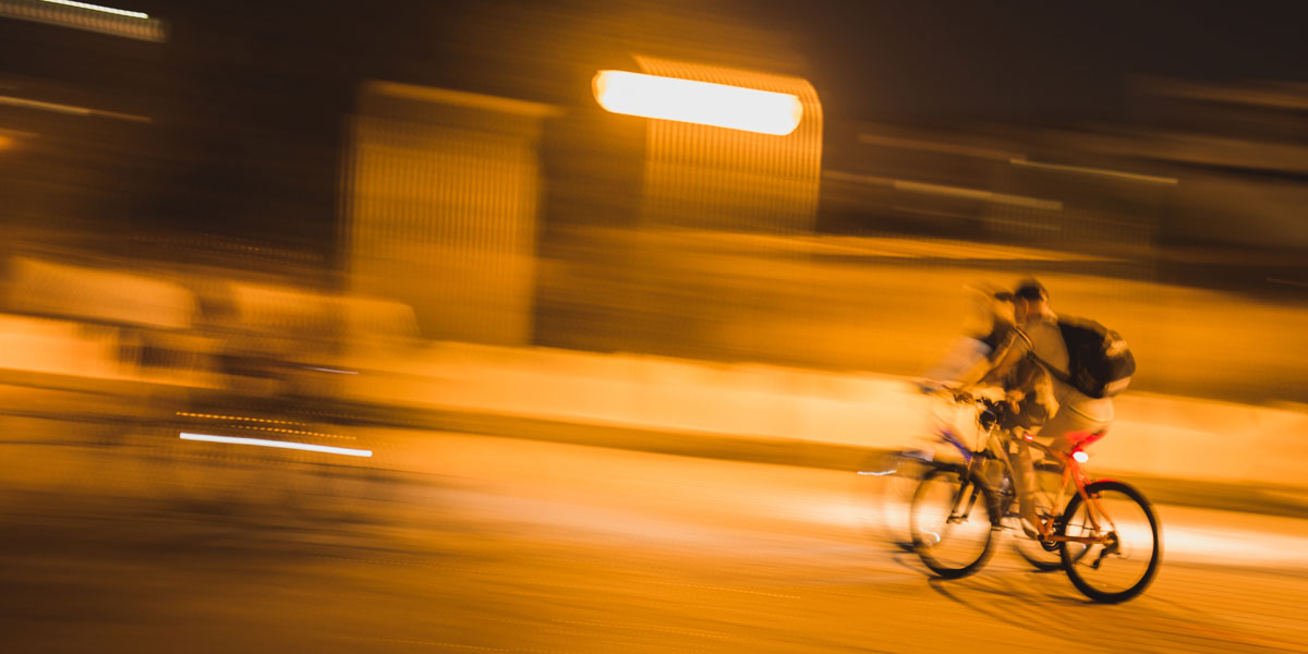 Cyclists on the road at night