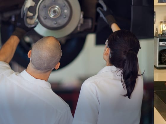 Two Les Schwab technicians examine one of the calipers of a car while it's on a lift.