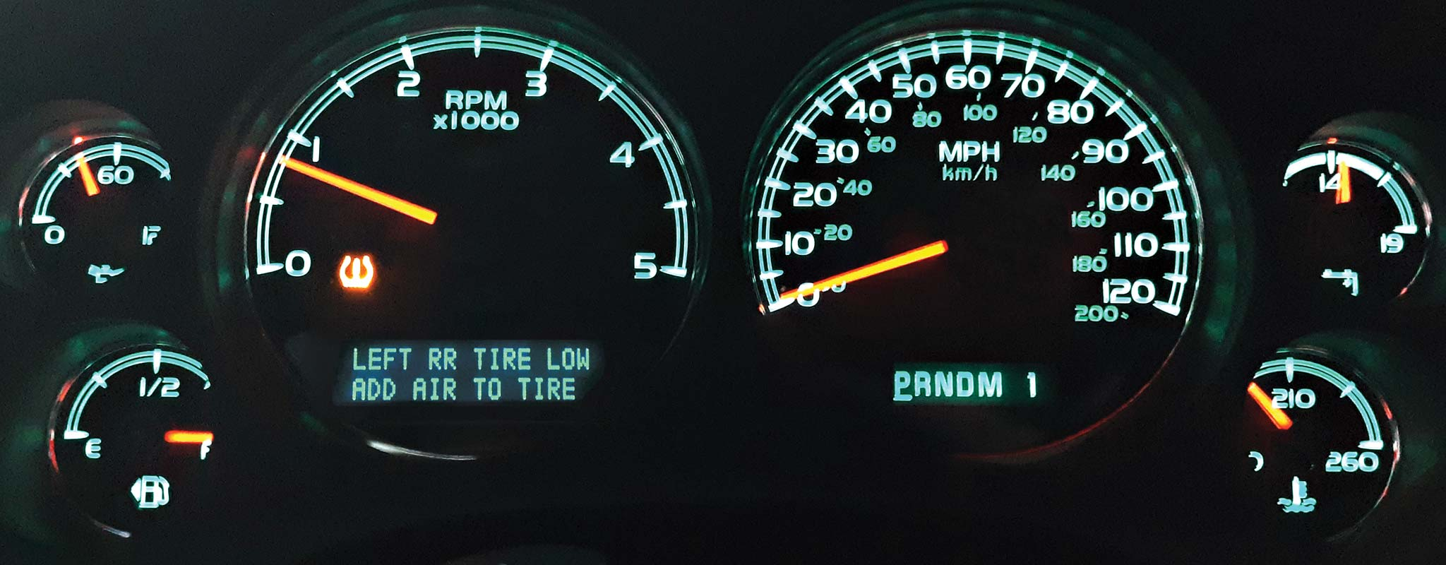 An illuminated dashboard with TPMS lights.