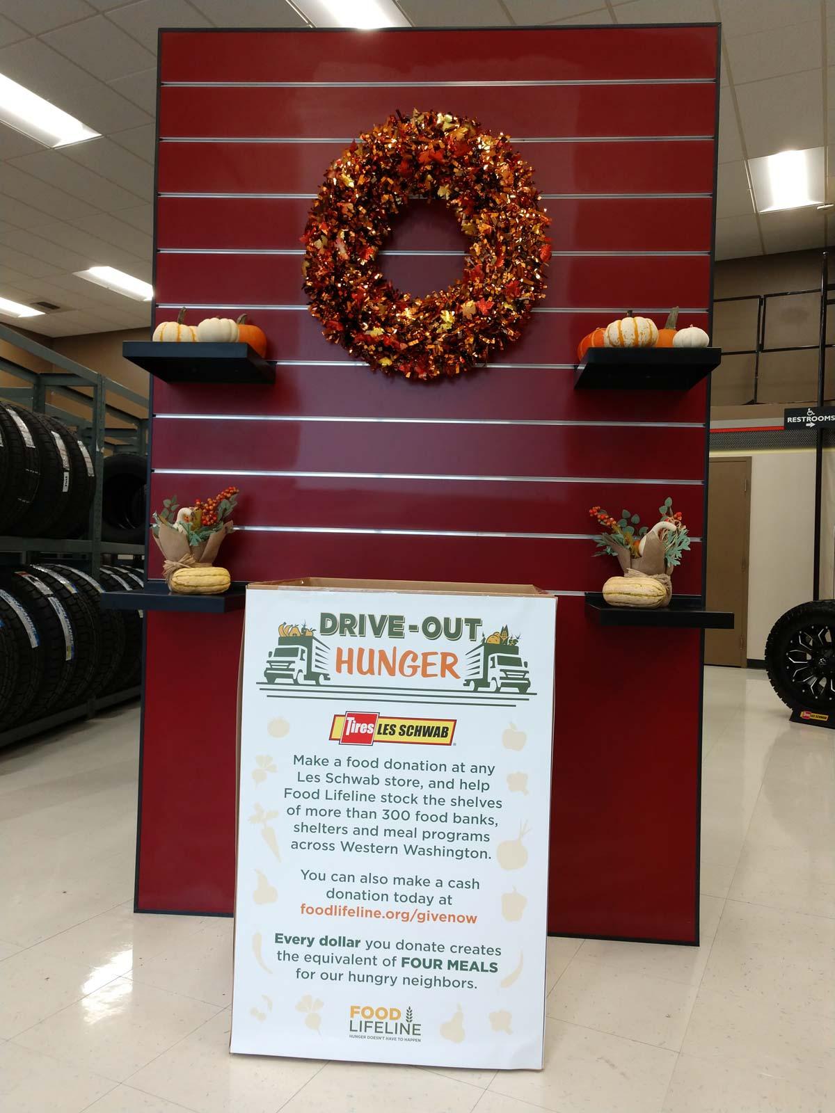 Food Lifeline food drive display in a Les Schwab store.
