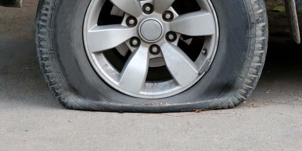 A flat tire on a car.