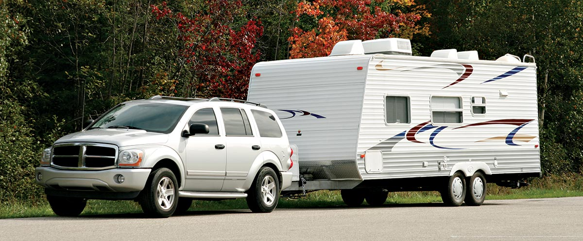 SUV with sagging rear hauling a camping trailer