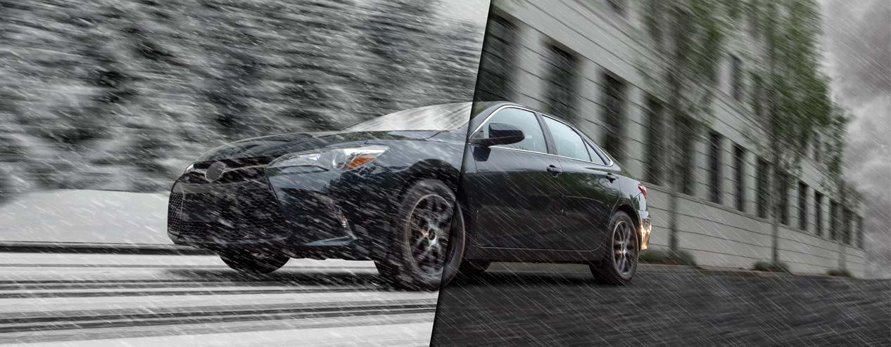 Car driving through snow and rain.