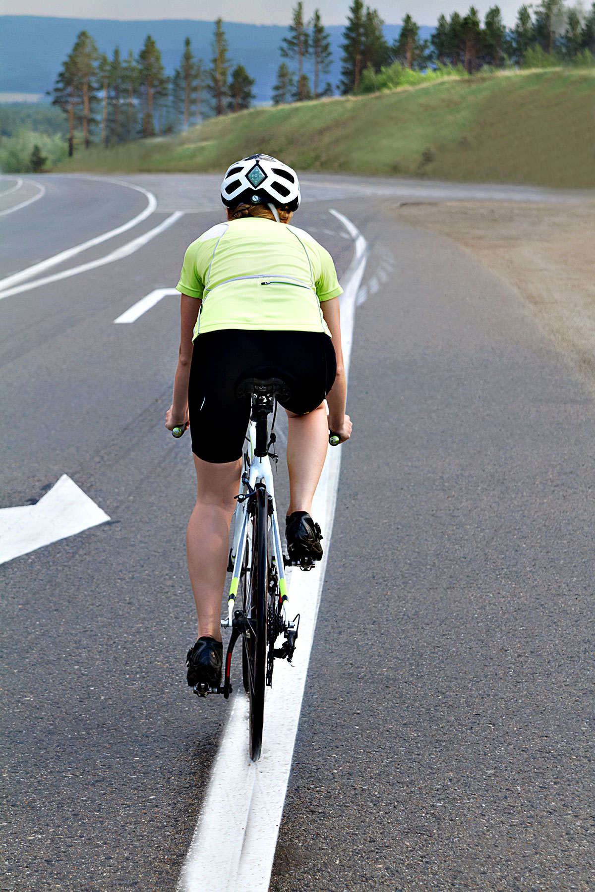 Cyclist on road shoulder