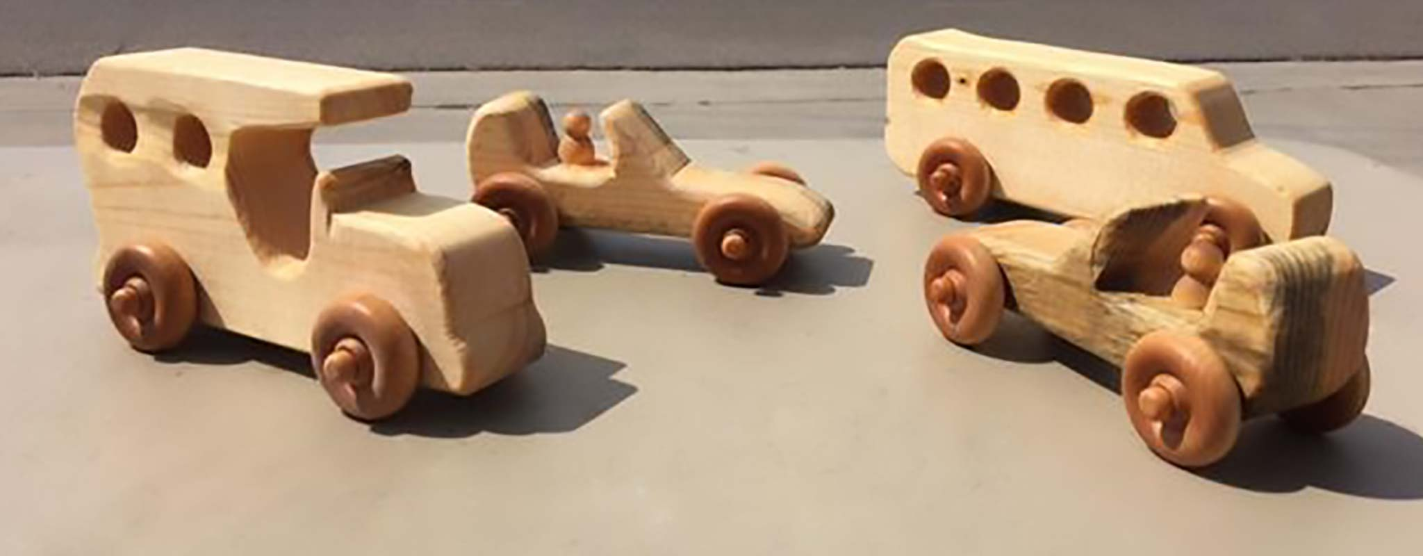 A set of hand carved wood cars.