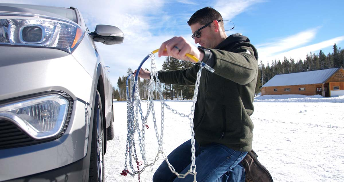 Man untangling tire chains.