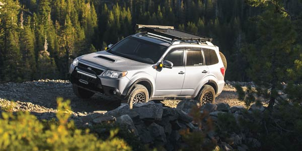 Silver Subaru Forester on a gravel mountain road