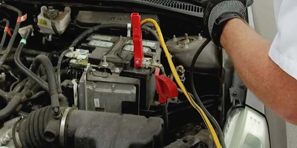 Jumper cables on a dead battery.
