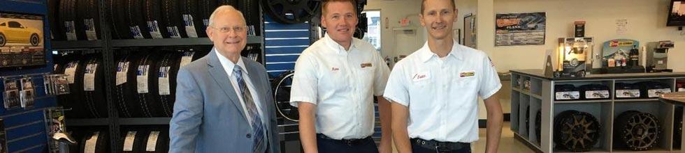 Doug Stephenson, Nathan Thies and Justin Brunson inside a Les Schwab Tire Center.