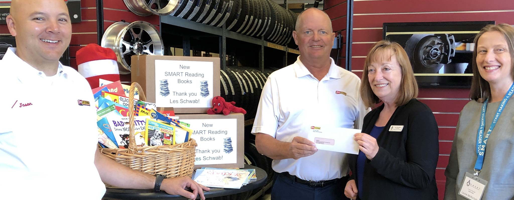 Les Schwab employees donating money that bought books for SMART in Lane County
