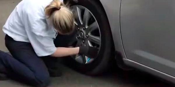 Tech checks tire pressure