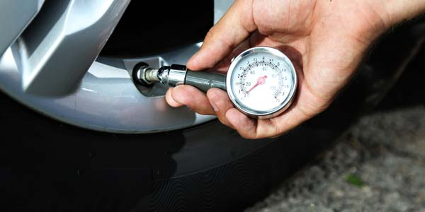 A thumbnail showing someone using a tire pressure gauge to check their tire