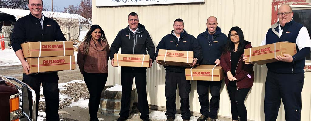 Les Schwab managers delivering hams to South Central Community Action Partnership in Idaho's Magic Valley