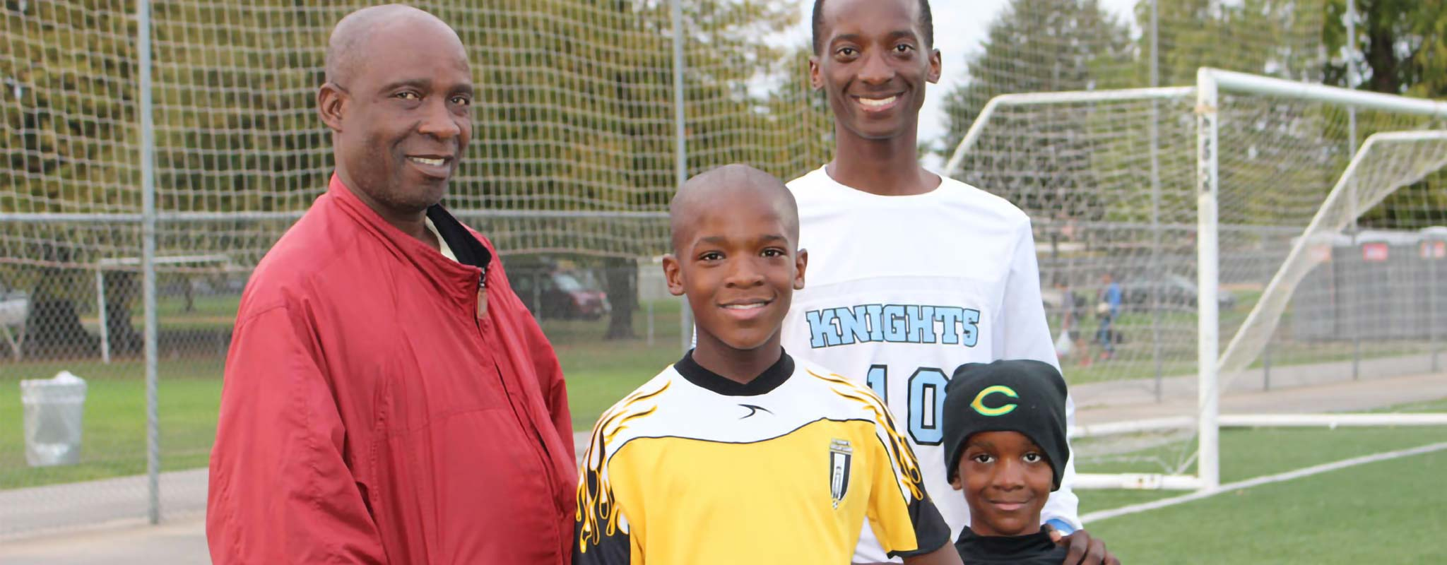Felix Songolo of the varsity boys' soccer team at De La Salle North Catholic High School with some family members.