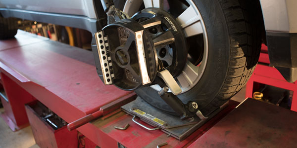 Wheel alignment tool mounted on a front tire.