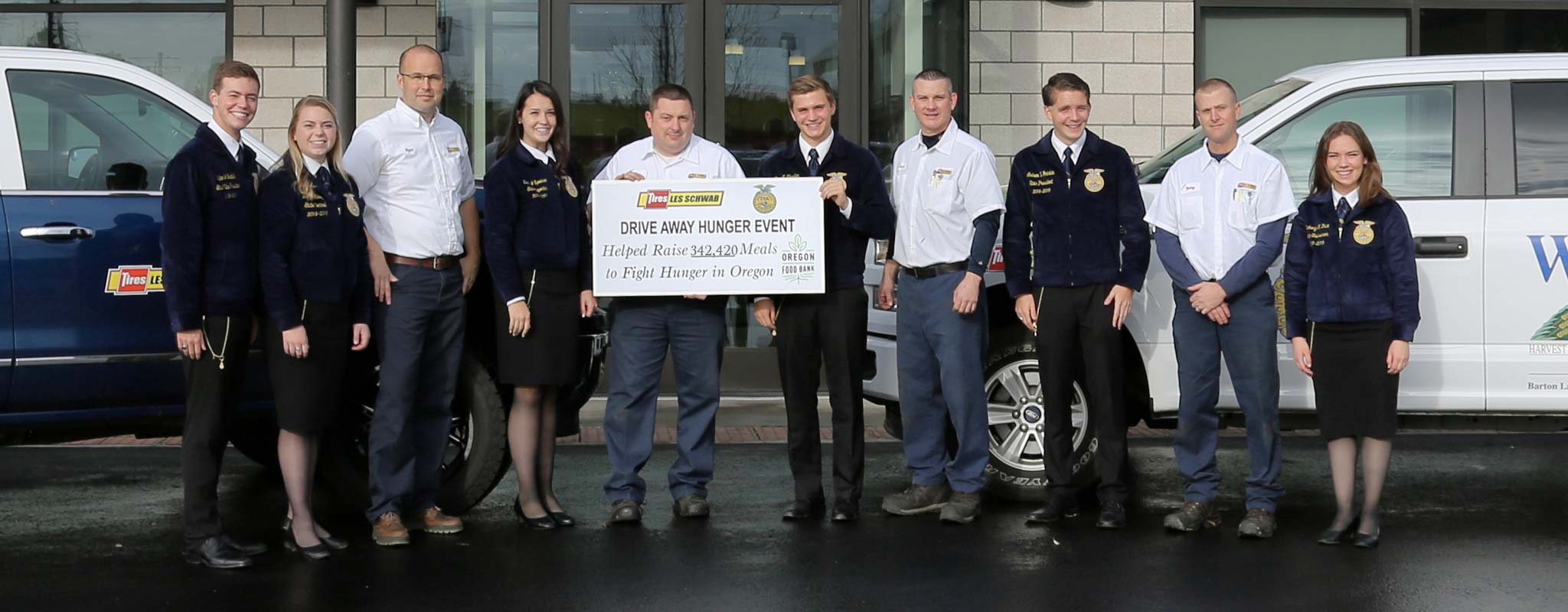 Les Schwab employees and Oregon FFA members standing in front of a Les Schwab store.