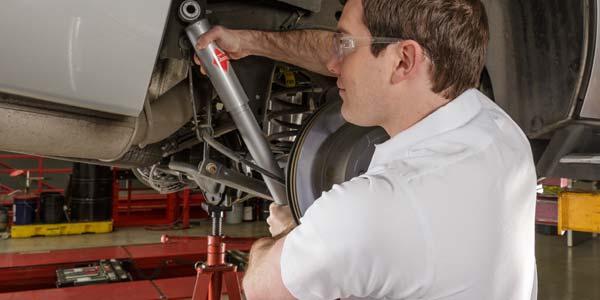 Technician installing a new shock.
