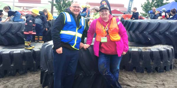 Woodland Les Schwab manager Brien Rose and his wife supervising children playing on giant tires at Dozer Day in Vancouver.