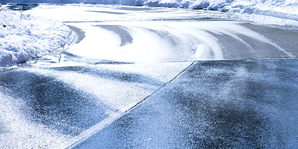 Icy winter road with curve