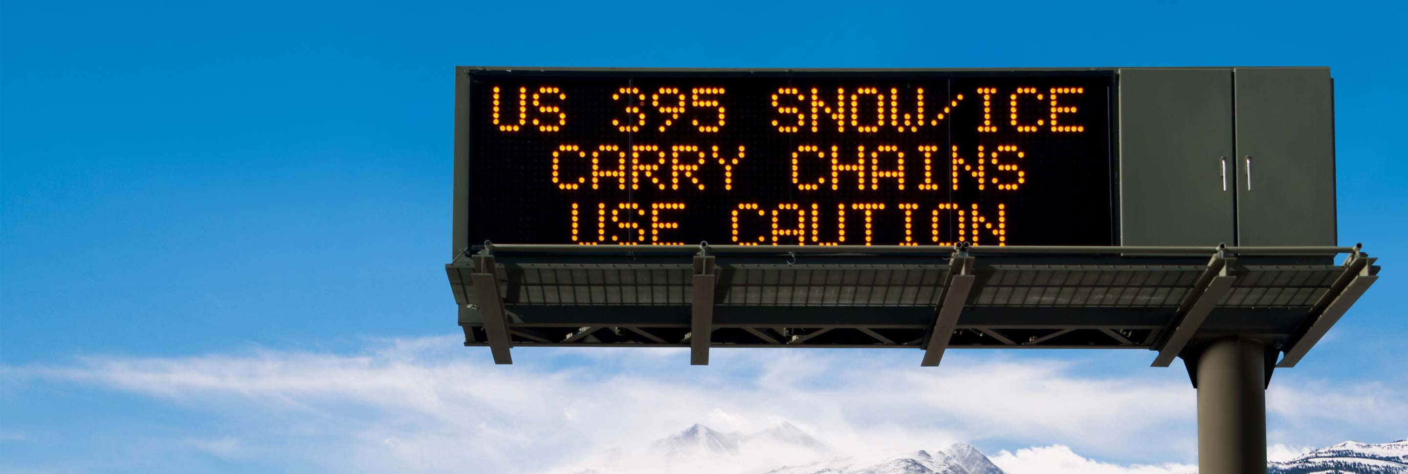 A highway sign warning of winter road conditions.