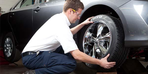 A Les Schwab technician removes a tire for a tire rotation.