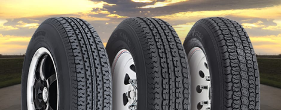 Three different tires lined up against a backdrop of a beautiful cloudy sky.