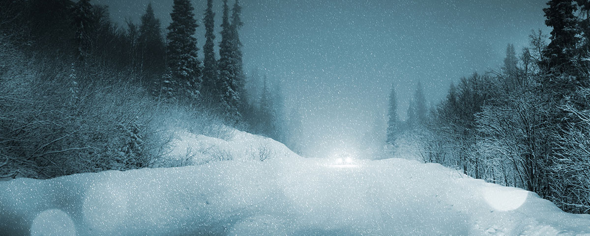Car traveling dark winter road