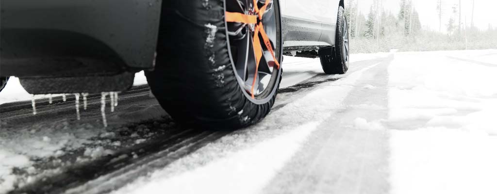 White SUV with tire sock installed on front tire