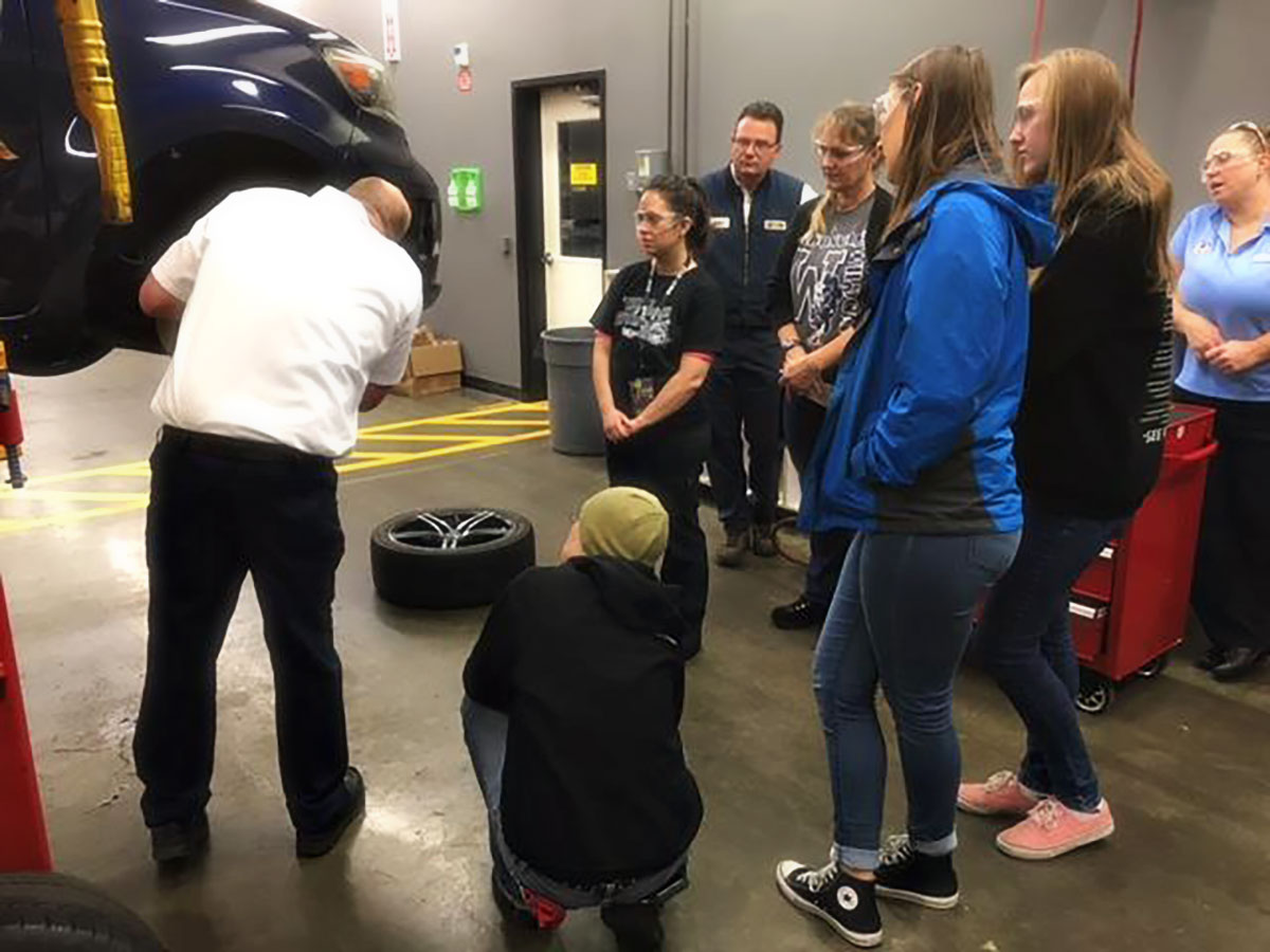 Dorian Moore and Kevin Leasure demonstrate how to change a spare tire