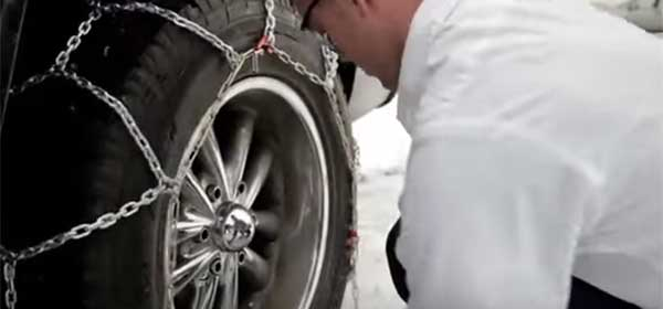 Step 7 - Man installing snow chain