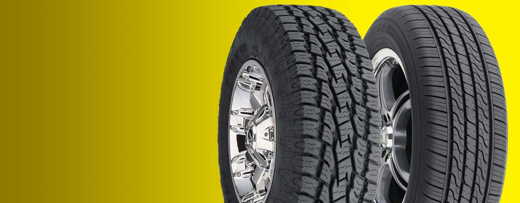 Assorted tires on yellow background.